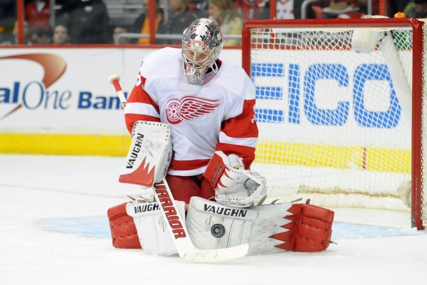 Detroit Red Wings goalie Jimmy Howard makes a save against the Washington Capitals at the Verizon Center in Washington Feb. 2. Howard, a former University of Maine player, will be competing for Team USA in the Sochi Olympics.