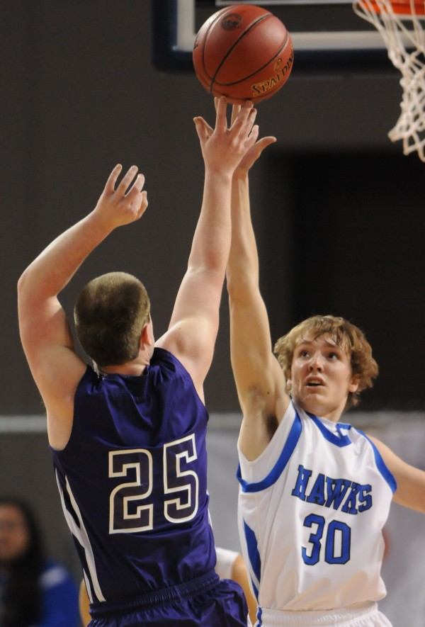 Hodgdon's Devon Quint (right) attempts to block a shot by Southern Aroostook's Kaleb Burpee on Saturday during Class D action at the Cross Insurance Center in Bangor.