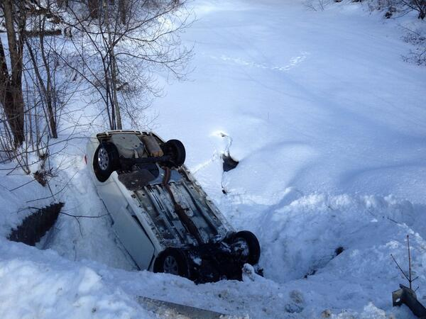 A car sits upside down in a ditch off Eastern Avenue in Brewer on Thursday morning.