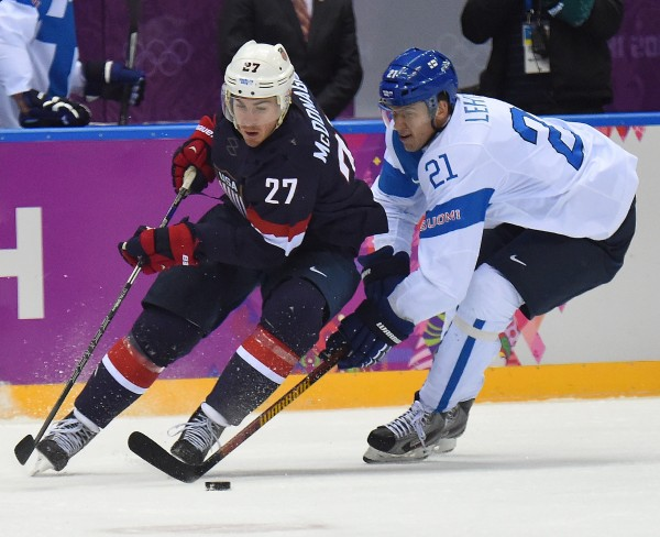 USA defenseman Ryan McDonagh (left) is defended by Finland forward Jori Lehtera during the first period of the men's Bronze medal hockey game at the Winter Olympics in Sochi, Russia, on Saturday. Finland defeated USA 5-0 to capture the bronze medal.