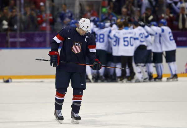 Team USA's Zach Parise skates away as Finland celebrates their win in their men's ice hockey bronze medal game at the Sochi 2014 Winter Olympic Games on Saturday.
