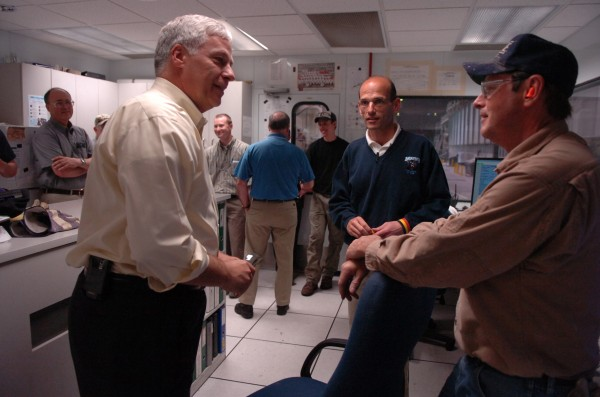U.S. Rep. Mike Michaud (from left) and former Gov. John Baldacci visit workers in the control room of Katahdin Paper Co. LLC in May 2008 after the Millinocket mill announced it would close.