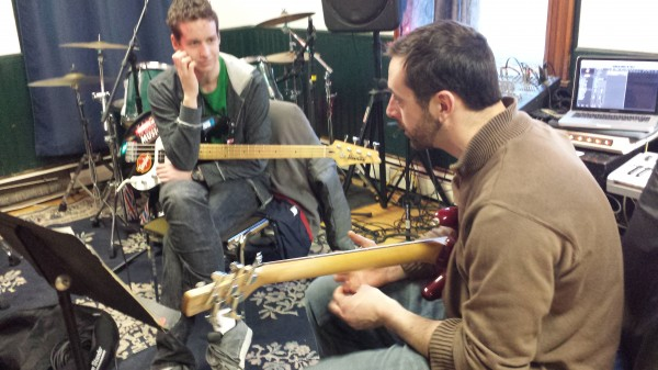 Kelly Bryand (right) gives a bass guitar lesson to Wolf Mullen (left), 17, of Sullivan at Maine Academy of Modern Music studio in Machias.