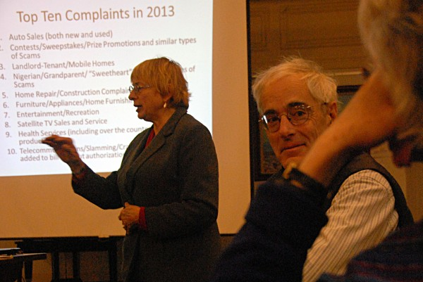 Sen. Geoff Gratwick, D-Bangor (right), organized a seminar at the Bangor Public Library on Saturday, Feb. 15, 2014, in which Maine Attorney General Janet Mills (left) outlined the latest scams and frauds that Mainers can fall victim to.