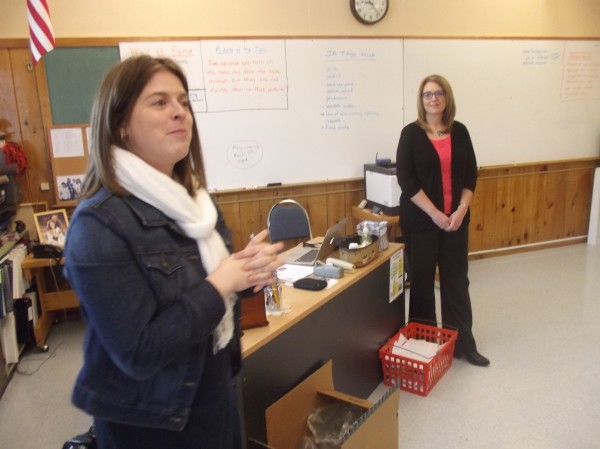 Christy Alley (left), a teacher at Machias Memorial High School, addresses her Jobs for Maine Graduates students as Lanette Pottle (right) looks on.