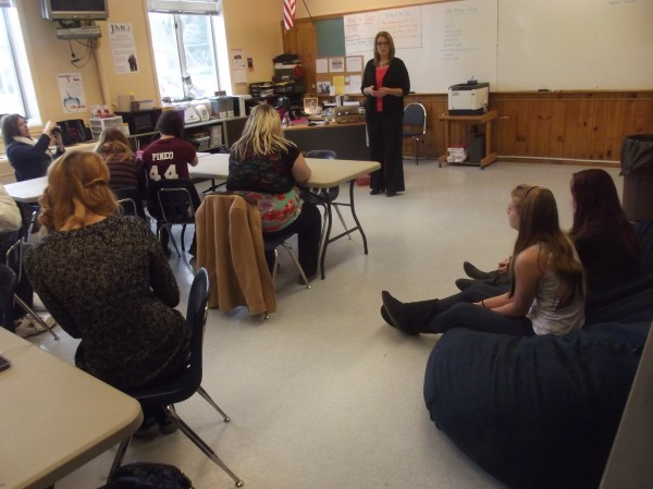 Lanette Pottle of Robbinston addresses students at Machias Memorial High School. She provided $10 for each student to use to help someone else in an initiative Pottle calls Kindness to the Power of Ten.