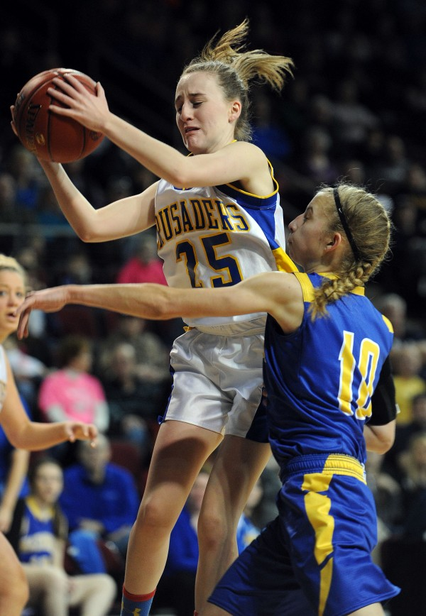 Van Buren's Courtney Parent (center) rebounds with pressure from Washburn's defense Joan Overman on Saturday during Class D action at the Cross Insurance Center in Bangor.