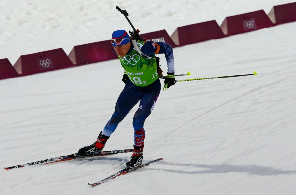 Russell Currier competes in the men's 4x7.5km relay during the Sochi 2014 Olympic Winter Games at Laura Cross-Country Ski and Biathlon Center.