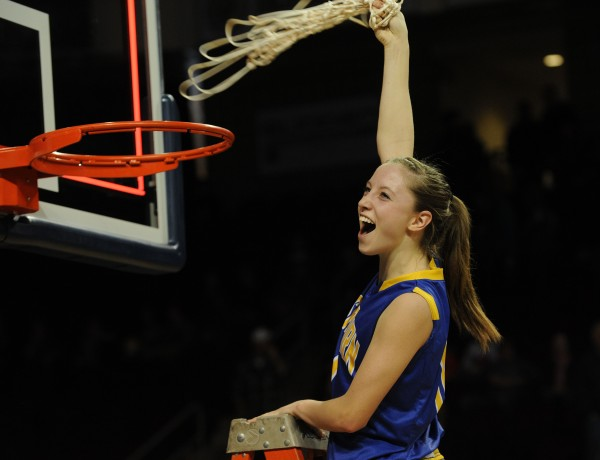 Washburn's Carsyn Koch pulls down the net after Washburn defeated Van Buren on Saturday during Class D action at the Cross Insurance Center in Bangor.