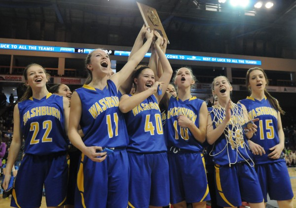 Washburn's girls team celebrate with the Class D Eastern Maine trophy after defeating Van Buren on Saturday at the Cross Insurance Center in Bangor.