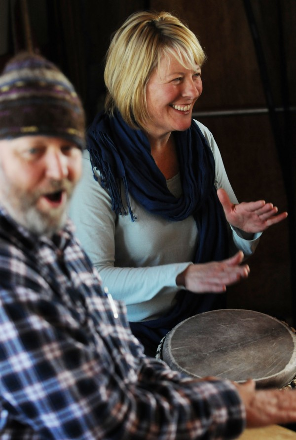 Christine Swersey of Southwest Harbor plays a djembe alongside Michael Bennett during a West African drumming workshop at Common Good Soup Kitchen in Southwest Harbor on Sunday Feb. 9, 2014.