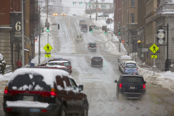 Vehicles travel up State Street in Bangor on Friday morning after a storm that brought several inches of snow Thursday into Friday morning.