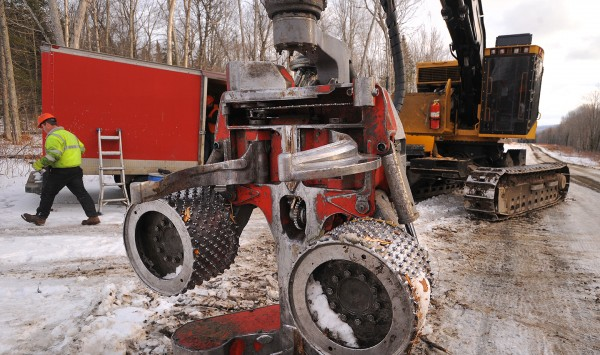A tree harvester is shown on Maine land owned by J.D. Irving Ltd. High-tech machines such as this one are equipped with a computer that keeps track of the amount of wood harvested, and the operators follow GPS coordinates to make sure they are cutting in the exact area determined by foresters.