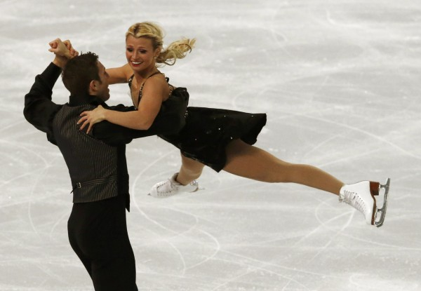 Kirsten Moore-Towers and Dylan Moscovitch of Canada compete during the team pairs free skating program at the Sochi 2014 Winter Olympics on Saturday.