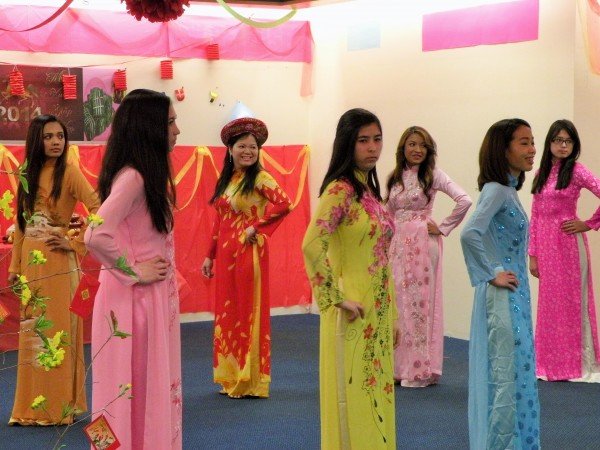 Participants display Vietnamese fashions during a celebration Saturday marking the lunar new year holiday known as Tet at the former Blockbuster store in Bangor.