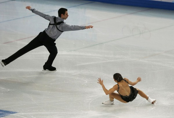 Marissa Castelli stumbles as she and Simon Shnapir of the United States compete during the team pairs free skating program at the Sochi 2014 Winter Olympics on Saturday.
