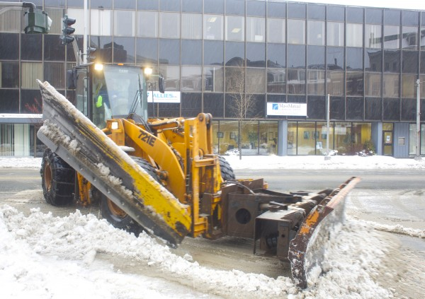 Plows clear the streets in downtown Bangor on Friday morning after a storm that brought several inches of snow mixed with rain. The storm created slush and icy conditions throughout the Bangor area.