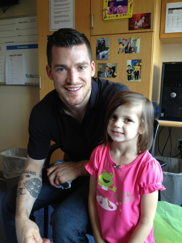 Maggie Rudnicki, 5, of Levant is shown above with one of her heroes, former Boston Bruins defenseman Andrew Ference, who now is team captain of the Edmonton Oilers.