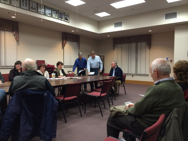 Two members of the Orono-Veazie Water District trustees and Water District Superintendent Dennis Cross, center, sit down at the head of the table during a Jan. 29, 2014 meeting of the Orono finance-community development-operations committee, where they gave an update about problems the water district is facing.