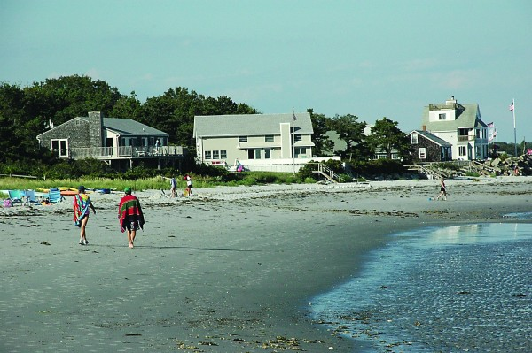 People walk on Goose Rocks Beach in this November 2013 file photo.