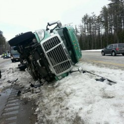 Turnpike tractor-trailer rollover results in fuel spill, bottlenecks