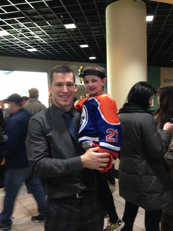 Maggie Rudnicki, 5, of Levant and former Boston Bruins defenseman Andrew Ference, now of the Edmonton Oilers. The two became friends after meeting at a Bruins game in March of last year.