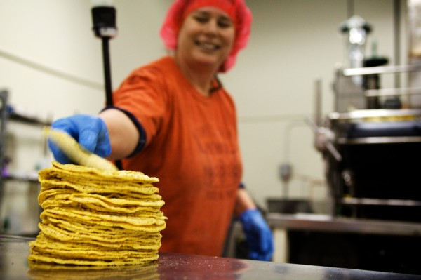 Lynne Rowe of Tortilleria Pachanga in Portland stacks hot corn tortillas as they come off the line Thursday morning. &quotI want to make a really great, fresh tortilla with corn that's grown from as close as possible,&quot said the former Spanish teacher, who lives on Munjoy Hill.