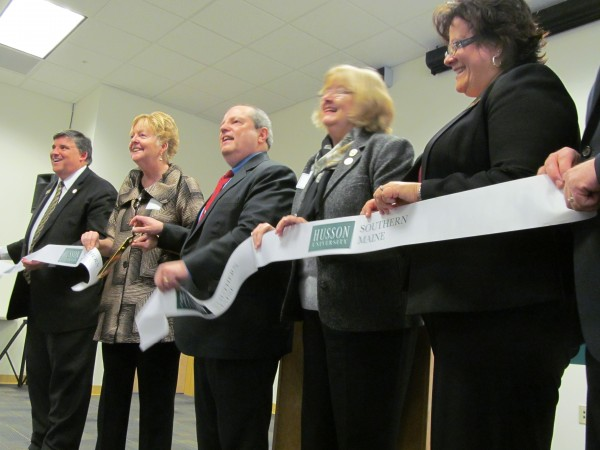 Cutting the ceremonial ribbon on Husson University's new southern Maine campus in Westbrook Tuesday were new campus executive director Charles Collins (from left), Westbrook Mayor Colleen Hilton, Husson President Robert Clark, university trustees chairwoman Carol Kanar, and university Senior Vice President and Provost Lynne Coy-Ogan. Just off camera is Matthew Cook, president of Allied Cook Construction, which renovated the property 340 County Road property for Husson.