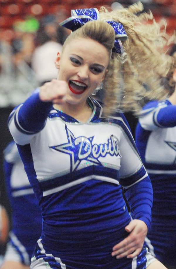 A cheerleader for the Lewiston High School Blue Devils performs a routine at the state competition in Augusta on Saturday.