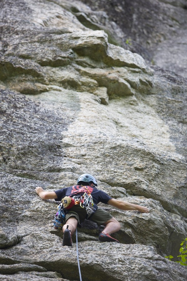 Jared Garfield, manager of rental equipment and repairs at the Maine Bound Adventure Center, climbs the 5.7+ route Highlander at Eagle Bluff in Clifton.