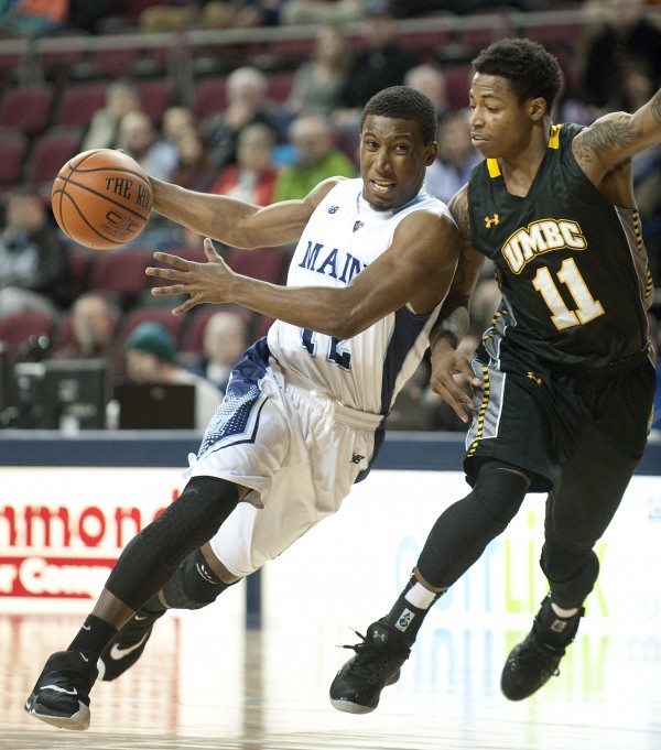 Xavier Pollard of the University of Maine (left), pictured during a Feb. 1 game in Bangor, will lead the Black Bears into Wednesday night's America East home contest against Hartford at the Cross Insurance Center in Bangor.