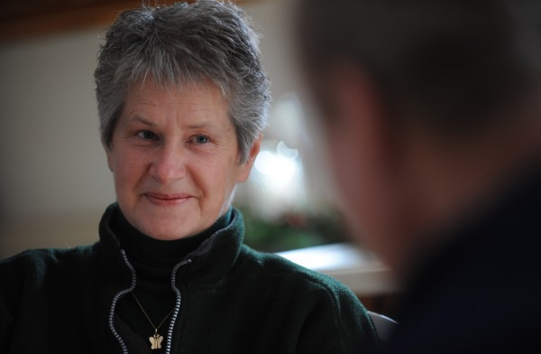 Dora Winslow smiles as she listens to her husband Don Winslow talk about his fight with cancer during an interview at their Hermon home in this January 2012 file photo. Don Winslow's cancer returned in February.