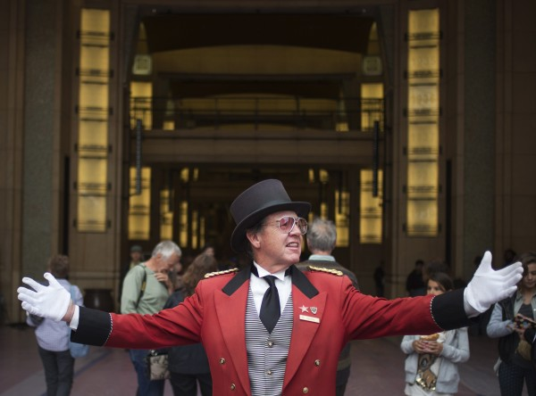 Gregg Donovan greets visitors as they walk past the red carpet outside the Dolby Theater ahead of the 86th Academy Awards in Hollywood, Calif., on Wednesday. The Oscars will be presented at the Dolby Theater on March 2, 2014.