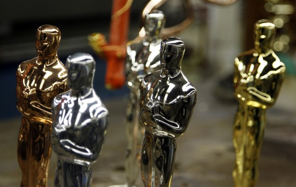 Oscar statuettes in the five steps of manufacturing, (from left to right) Copper, Britannia Pewter Base, Nickel, Silver and 24 Karat Gold, are seen during a media tour of the R.S. Owen and Company in Chicago in this February 2012 file photo.