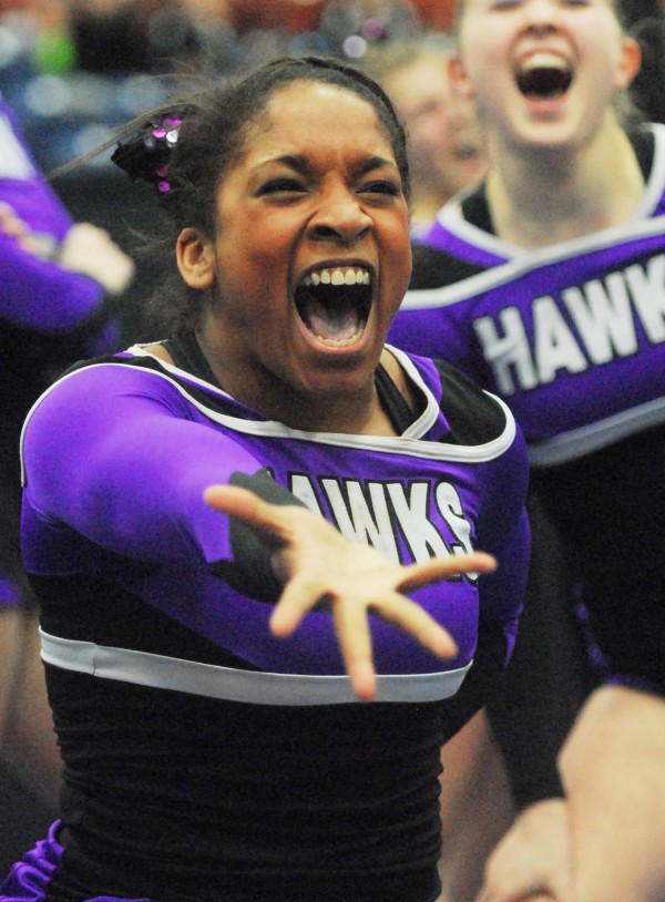 A cheerleader with the Hermon High School Hawks performs at the state competition in Augusta on Saturday.