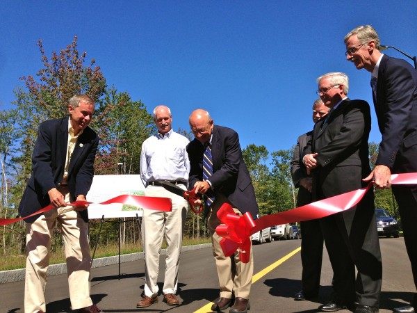 Portland Mayor Michael Brennan cuts the ceremonial red ribbon to officially open the Portland Technology Park, a 40-acre site devoted to growing the area's life sciences industry, in 2013.
