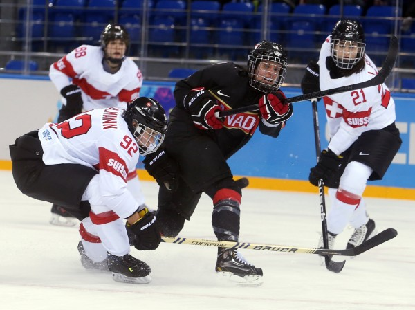 Canada's Laura Fortino (center) takes a shot against Switzerland during the first period in a women's hockey game at the Winter Olympics in Sochi on Saturday.