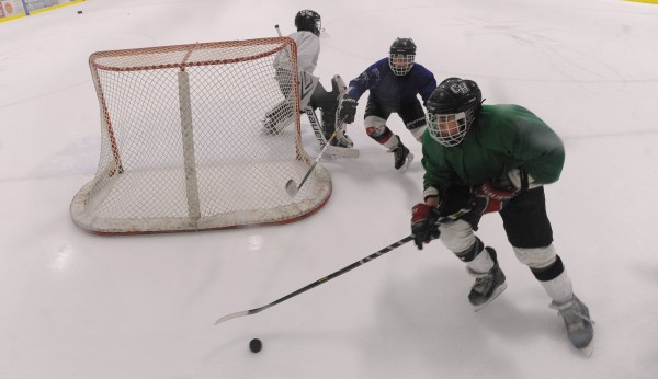 Camden Hills High School hockey players practice at the Midcoast Recreation Center in Rockport recently.