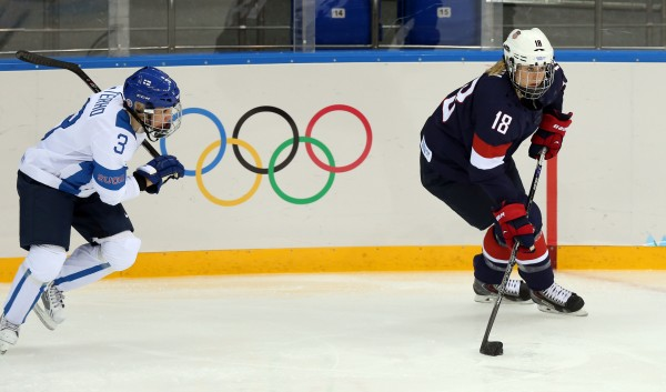 USA forward Lyndsey Fry (right) carries the puck past Finland's Emma Terho during the women's ice hockey preliminary round game in the Sochi 2014 Olympic Winter Games on Saturday.