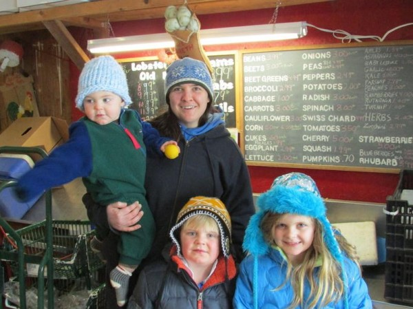 Caitlin Jordan of Alewive's Brook Farm in Cape Elizabeth stands with her niece and nephews (clockwise from bottom right) Emery Rideout, 7, Sam Rideout, 5, and Bennett Rideout, 1.