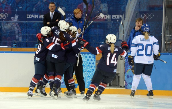 USA players celebrate a goal by forward Hilary Knight (21) during the women's ice hockey preliminary round game against Finland in the Sochi 2014 Olympic Winter Games on Saturday.