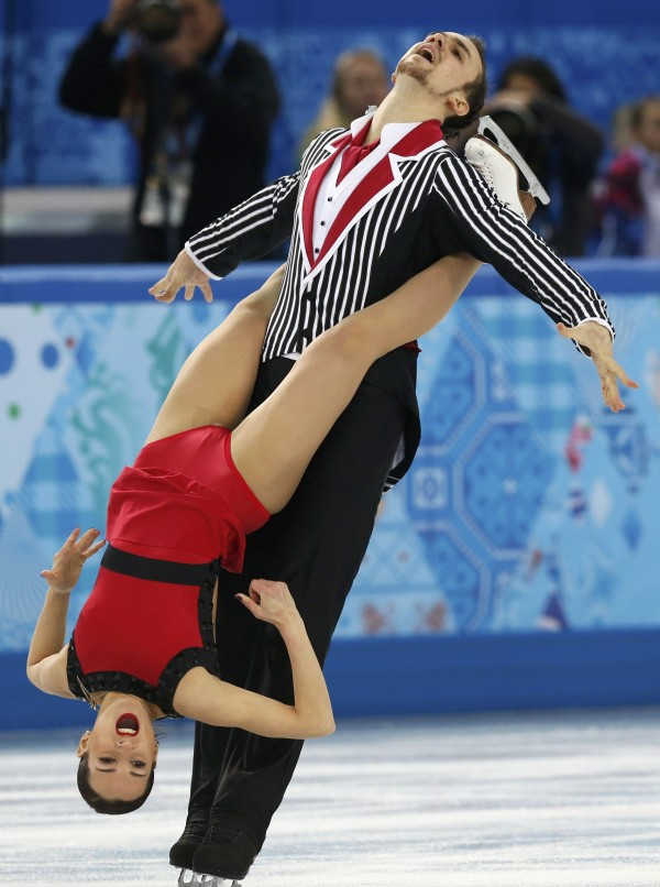 Ksenia Stolbova (bottom) and Fedor Klimov of Russia compete during the figure skating team pairs free skating at the Sochi 2014 Winter Olympics on Saturday.