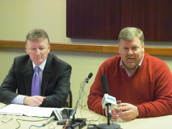 Ron Cain (right), new majority owner of the Portland Pirates hockey team, fields questions from reporters Tuesday afternoon at Holiday Inn By the Bay. Cain joined Neal Pratt (left), chairman of the Cumberland County Civic Center board of trustees, for a news conference announcing a new five-year lease deal that will return the team to Portland.