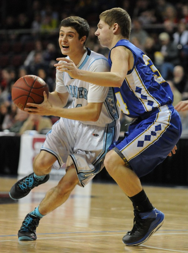 Oceanside's Keenan Hendricks looks to pass with pressure from Hermon's Garrett Kipler on Saturday at the Cross Insurance Center in Bangor.