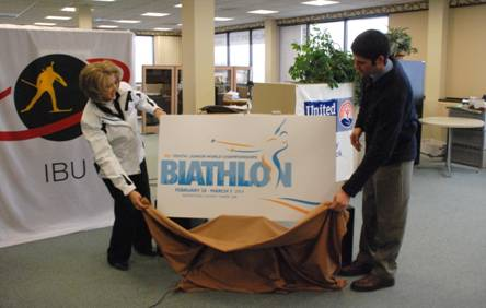 2014 IBU Youth/Junior Biathlon World Championships Event Director Jane Towle and the Maine Winter Sports Center's Mike Smith unveil the event logo at a press conference in Presque Isle in this February 2013 file photo.