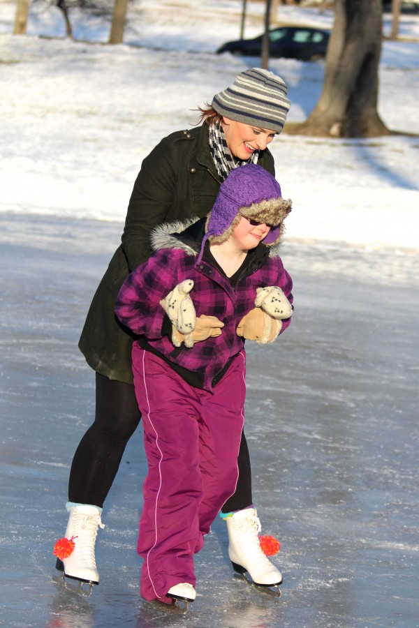 Margaret Thurlow, 15, of Hampden, learns how to skate with the help of her friend Mary Priesing of Bangor on Jan. 30, 2014, at the outdoor ice rink at Broadway Park in Bangor.