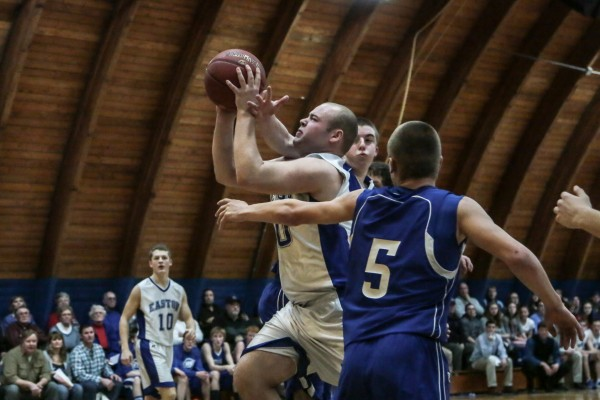 Easton High School's Connor Burtt takes the ball to the basket against Central Aroostook's Chandler Brewer and Dustin Pryor on Jan. 30 in Easton.