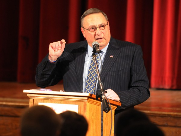 Gov. Paul LePage speaks to a packed auditorium at John Bapst Memorial High School on Dec. 6, 2013, about domestic violence. Kevin Bennett | BDN