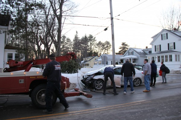 A car involved in an accident on Buck Street on Saturday is prepared for towing.