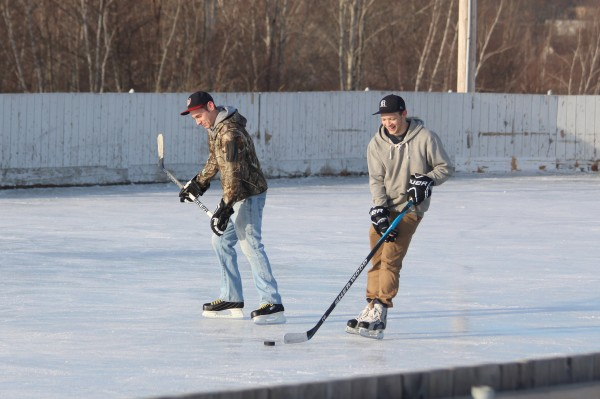 Ryan Tesseo, 21, of Orrington (far left) and his friend Jacob Cyr, 20, of Bangor, practice ice hockey skills on Feb. 4, 2014, at the Caldwell Ice Rink in Brewer.